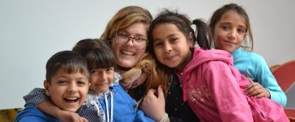 Female volunteer working with children in Romania at a care centre for her Childcare Project.